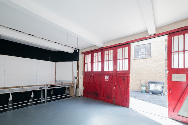 Bermondsey Printworks Industrial Event Space - interior with red sliding doors